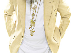 Chestshot - T-Pain in a yellow blazer, white shirt, sunglasses and wearing jewelry