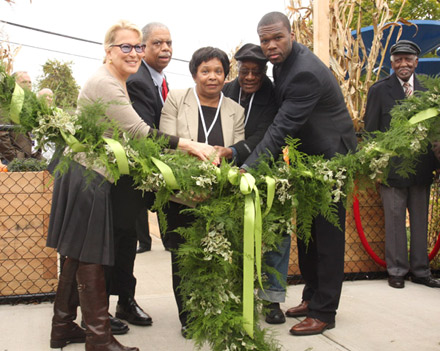 50 Cent and Bette Midler cut the garland at community garden in Jamaica, Queens