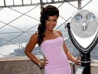 Ashanti in pink dress on top of the Empire State Building