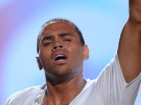 Chris Brown crying, one finger in the air at the 2010 BET Awards