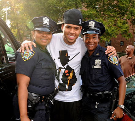 Chris Brown poses with female police officers at Rucker Park