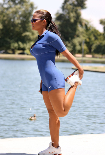 Christina Milian jogging in a park.