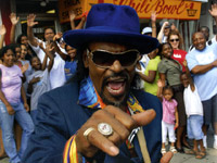 Chuck Brown flahses pinky ring - Swindle Magazine