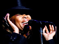 Erykah Badu singing at Roseland, black hat and jacket