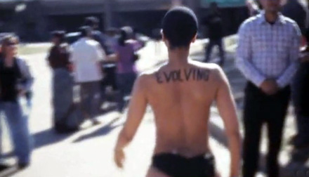 Erykah Badu walking in a park in no bar, evolving inked on her back