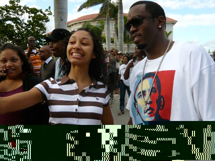 Diddy takes a picture with voter on voting line in Florida