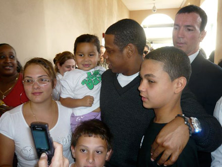 Jay-Z cradling a a baby girl on voting line in Florida