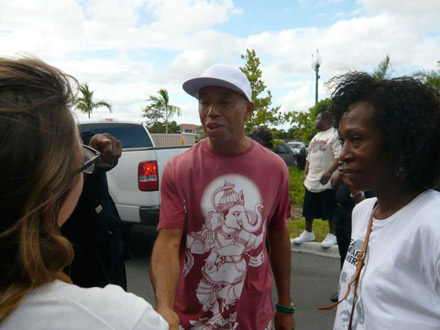 Russell Simmons greets voters on voting line in Florida