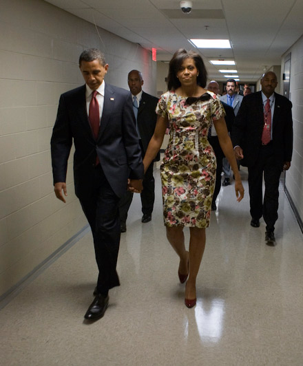 Barack Obama and Michelle Obama walk down the hallway