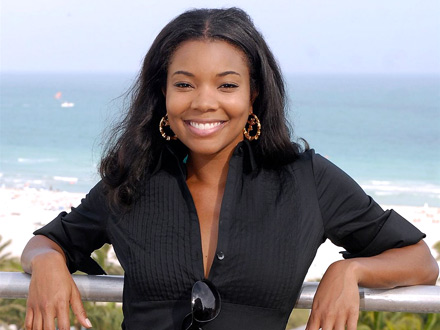 Gabrielle Union lounges on a hotel balcony