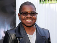 Gary Coleman sporting a black leather jacket and sunglasses