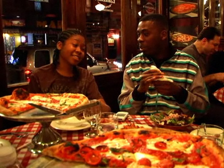 GZA and his son Karrem Justice eat pizza in New York restaurant