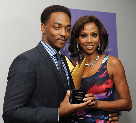 Anthony Mackie presents Holly Robinson with the Hennessy Privilege Award