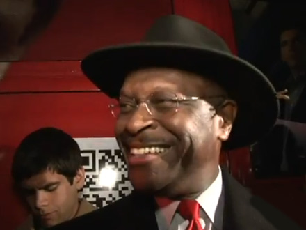 Herman Cain takes questions with a smile