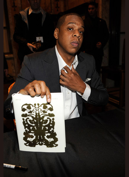 Jay-Z holding Decoded at the New York Public Library