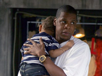 Jay-Z holding a child