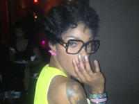 Joseline Hernandez wearing a yellow and green dress and Cazals