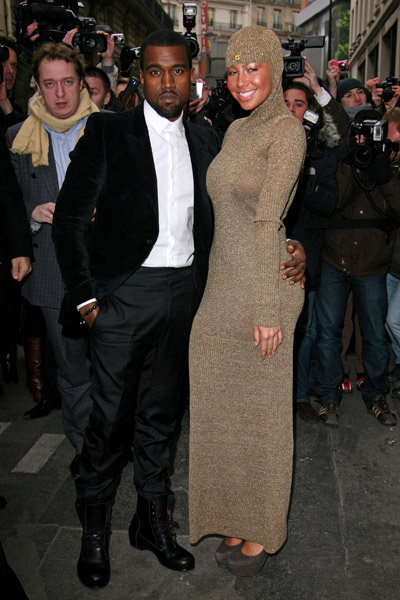 Kanye West and Amber Rose strike a pose at Chanel Haute-Coutore fashion show in Paris