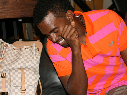 Kanye West in the studio, in a pink and orange shirt