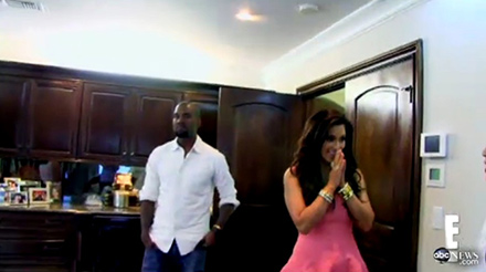 Kanye West in a white button down and Kim Kardashian in a pink dress