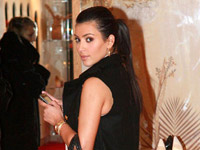 Kim Kardashian checks her Blackberry