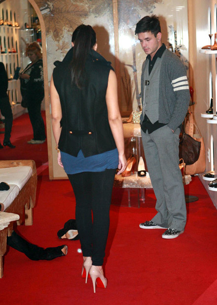 Kim Kardashian shows off shoes in a Beverly Hills store - from the back