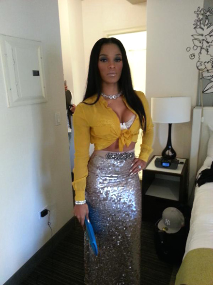 Joseline Hernandez poses in a silver skirt and yellow blouse