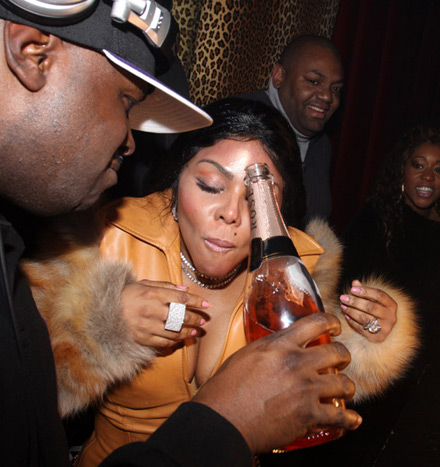 Lil Kim with a mouthful of Rose champagne