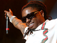 Lil Wayne thanks fans for 1 million Carter III sold