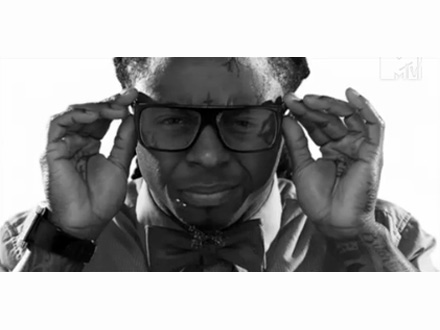 Lil Wayne adjusting his designer glasses.