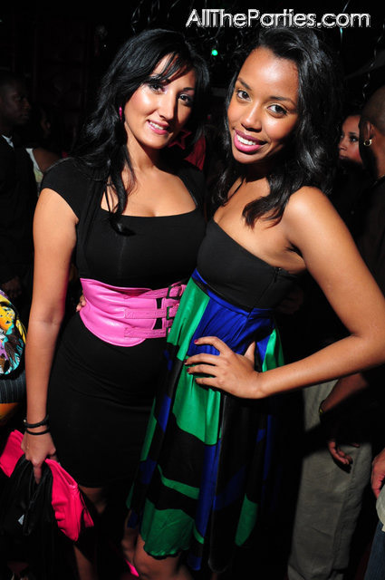 Pink belt, green and blue print dress, party goers at Mario Winans birthday party