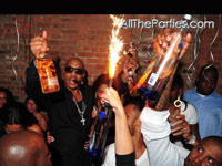 Popping bottles at Mario Winans birthday party