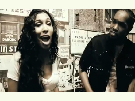 Melanie Fiona singing with a street performer