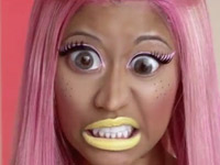Nicki Minaj with pink hair, big eyes and yellow lipstick