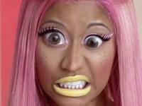 Nicki Minaj with pink hair, big eyes and yellow lipstick