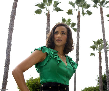 Paula Patton strikes a pose under some palm trees