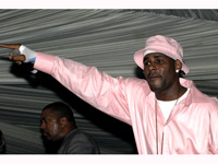 R. Kelly in a pink shirt.. it's party time