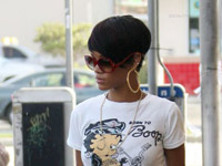 Rihanna leaves Popeyes with a soda