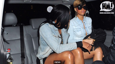 Rihanna and a friend in a limo/car at Club Mahiki