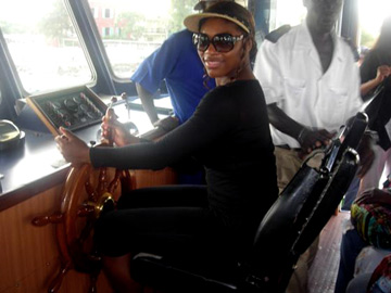 Captain Serena Williams steering a yacht
