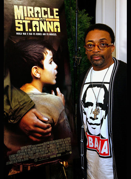 Spike Lee poses in front of Miracle at St. Anna poster