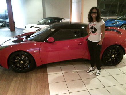 Alicia Keys stands next to her new, red Lotus Evora