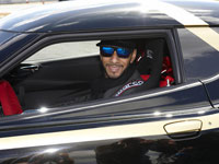 Swizz Beatz smiling in a black Lotus. You would too.