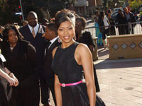 Taraji P. Henson in a black dress and pink purse