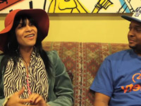 Teedra Moses smiling during BET interview with Jabari