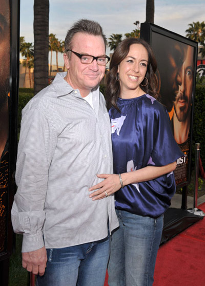 Tom Arnold in jeans and gray, plaid shirt at The Soloist premiere