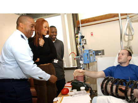 Tyra Banks and her brother Devin visit Walter Reed Medical Center