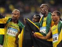 Usain Bolt with Jamaicain teammates win his third Olympic gold medal