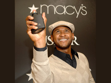 Usher mists the air at Macy's
