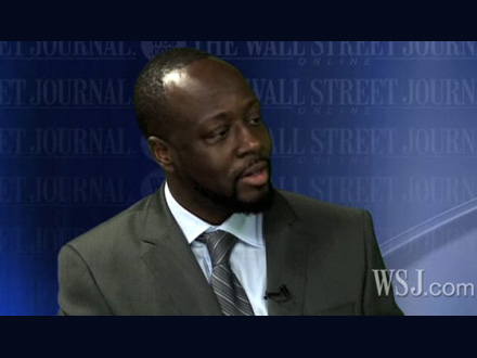 Wyclef Jean in a suit at the Wall Street Journal
